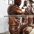 pengrajin patung tembaga